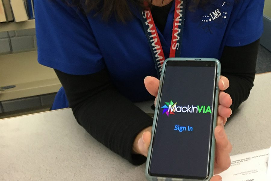 Librarian Megan Saladino shows how easy it is to use the new MackinViA app to access Longfellow's eBook and audiobook collection