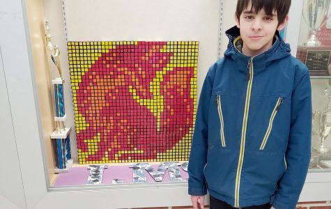 The Rubik's Cube club create pixelated pieces of art for display in the trophy case.  The current artwork shows a red fox.