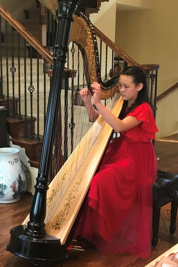 Student Harp Player Tackles Tough Instrument