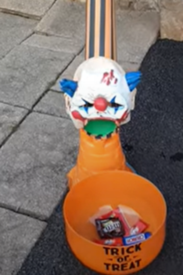 Journalist Henry K.'s family created this candy shute for safe delivery of candy to trick-or-treaters.